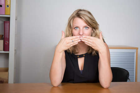 Pretty young woman dont want to speak Stock Photo