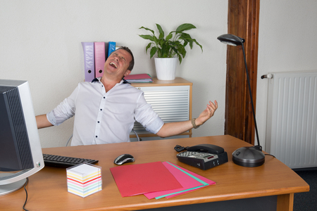arms wide open: Man with his arms wide open at office
