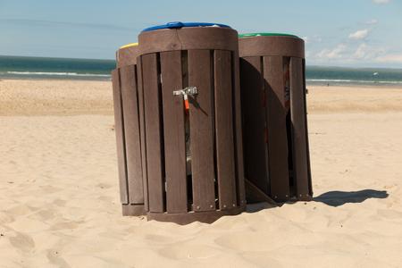 blue bin: Wood bin on the beach under blue sky