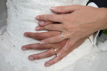 wedding dress: Bride and a groom holding hands at wedding day Stock Photo