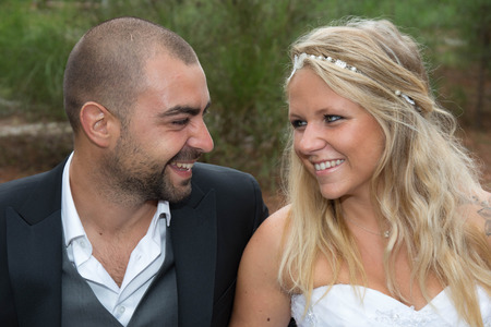 each: Bride and groom looking fondly of each other.
