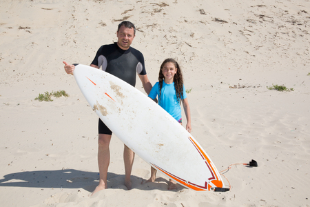 teaching adult: On the beach, a father and his daughter Stock Photo