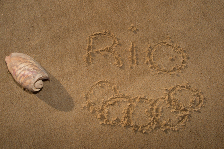olympic rings: Olympic rings drawn in the sand under Rio 2016 message on Ipanema Beach in anticipation of the city hosting the 2016 Summer Games. Editorial