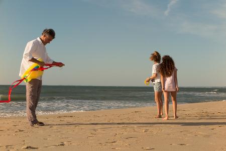 two generation family: Two Generation Family Having Fun On Beach Stock Photo