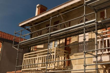 rockwool: Scaffolding on a house  under blue sky