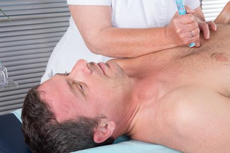 moxibustion: Alternative medicine therapist doing moxa treatment on her client Stock Photo