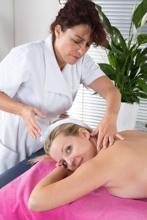 bioenergy therapy: Alternative medicine therapist using crystal to make a massage Stock Photo