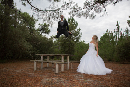 lovely couple: Beautiful and lovely couple, happy, the groom jumping