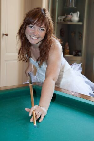 garret: Young newlywed bride playing billiards at her mansion