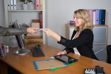 adviser: Woman meeting financial adviser in office