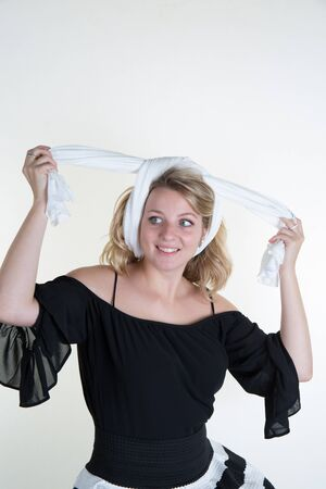 erotical: Beautiful young blond woman with blanck and white clothes Stock Photo