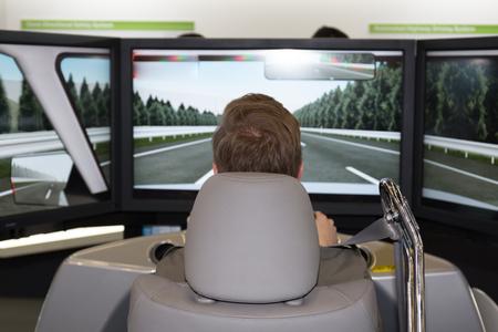 simulator: Man in an electric car simulator -