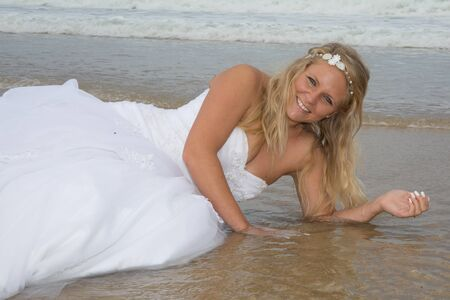 serf: Blond bride woman at the beach at summer time Stock Photo