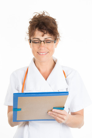 medical history: Female doctor writing a medical history in a folder isolated