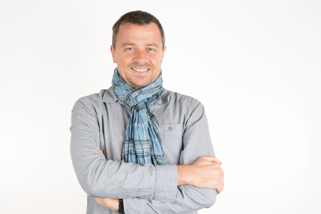 informal clothing: Smart man with scarf looking at the camera Stock Photo