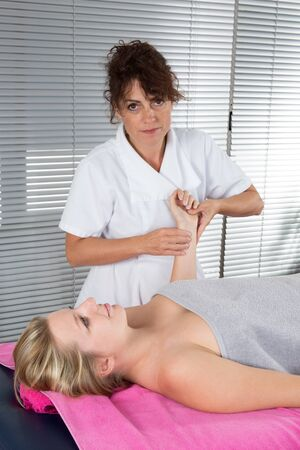 holistic care: Women therapist listen to the pulse of her patient with  the hands