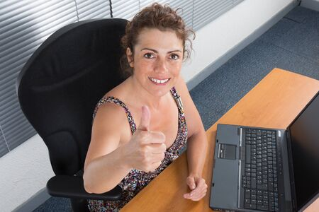 great suit: Happy thumbs up success woman at work