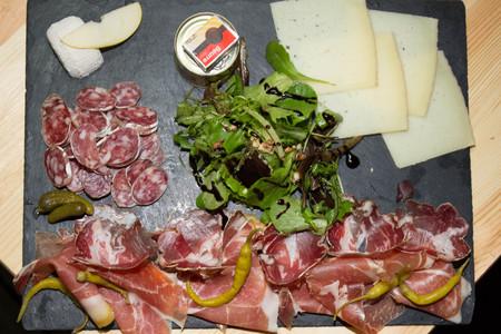 antipasto: Traditional italian antipasto with prosciutto, cheese, Stock Photo