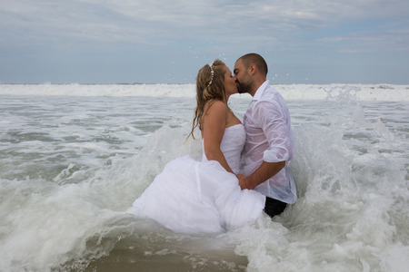 ocean and sea: Wedding couple at the beach with a wedding clothes Stock Photo