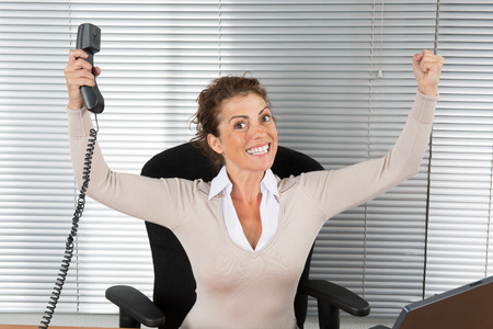 arms up: Good news -Successful business woman with arms up