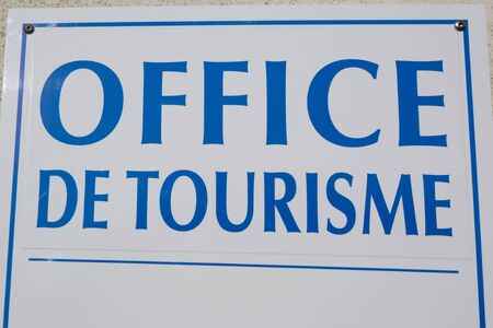hanged: French language  Office de Tourisme  hanged sign in France