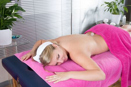 bellybutton: Young blond woman waiting for massage with crystals