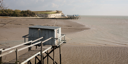 fishing cabin: Fishing cabin in the estuary. West coast of France Stock Photo