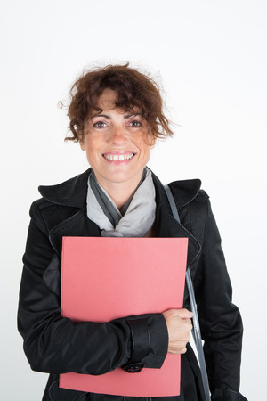 file clerk: Smiling business woman holding document on clipboard isolated on white background Stock Photo