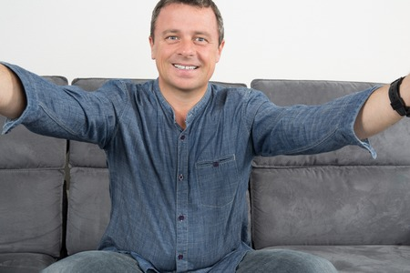 uploaded: Man is doing a selfie at home Stock Photo