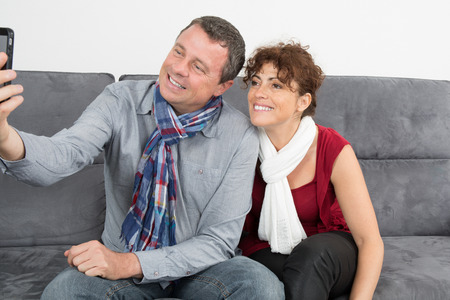 couple on couch: Happy couple watching Tv  at home on couch