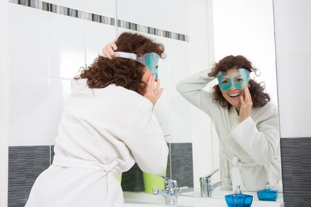 beautycare: Brunette woman worried by hair getting grey Stock Photo