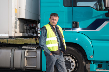 Serious and confident Man standing in front of truck