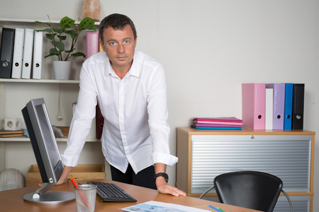 30 to 40 year old: architect standing in front of his office