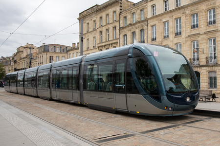 alimentation: Tram in the center of Bordeaux in France. The Bordeaux tramway network is notable for using a ground-level power supply of the Alimentation par Sol (APS) system.