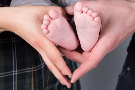 baby's feet: Babys feet, parents hands and baby feet