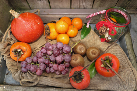 overfilled: Top view of Autumn fruits and vegetables under a wooden background