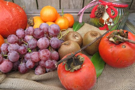 overfilled: Autumn fruits and vegetables under wooden background