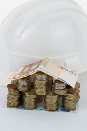 contribution: Money, house and helmet isolated on white background