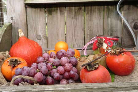 overfilled: Autumn fruits and vegetables under a wooden background