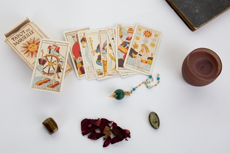 tarot cards with old book and candle