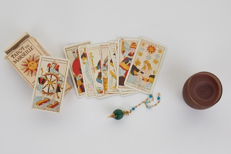 astral: tarot cards with old book and candle