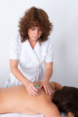 Cupping treatment on female at spa center - chinese treatment