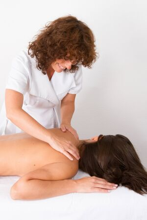 female therapist: Spa Hot Stone Massage given by a female therapist