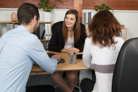 Financial advisor or lawyer giving advice to happy and lovely couple