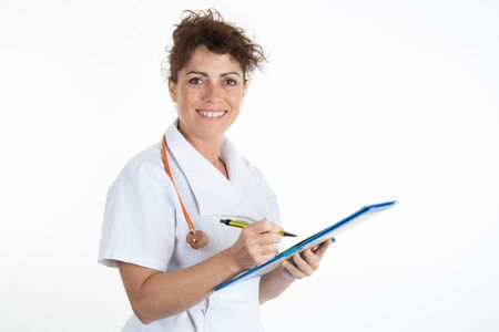 writing pad: Portrait of happy successful mature female doctor holding a writing pad copy space Stock Photo