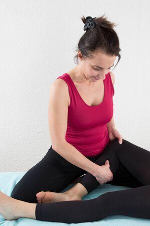 shiatsu: Woman having Shiatsu massage on knee