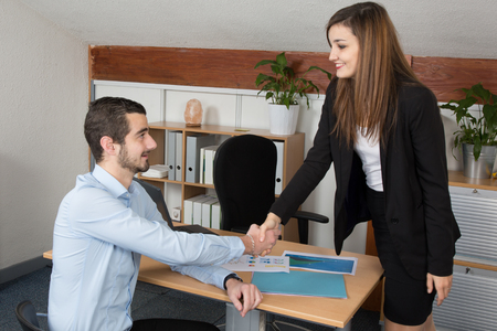 unanimous: Business people shaking hands, finishing up a business meeting