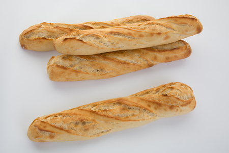 artisan bakery: Four Baguette bread loaves in a row isolated on white background