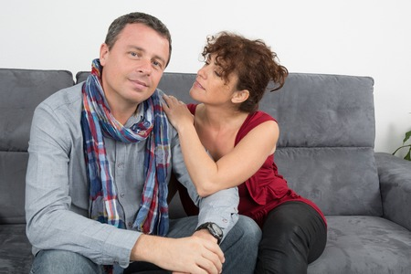 adult valentine: Romantic couple on sofa happy together and relaxing at the couch
