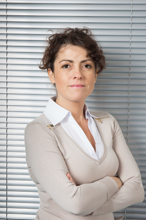 female lawyer: Female professional portrait. Caucasian businesswoman smiling. Executive in her forties Stock Photo